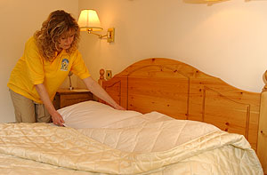 Home Cleaner Making a bed